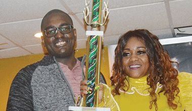 New Song Competition, and the first ever New Break-out Artiste winner Michelle 'Hibiscus' Hillocks (right) receiving trophy from Atiba Williams (left) Vice Chairman of the Cultural Association of Vincentians in the USA